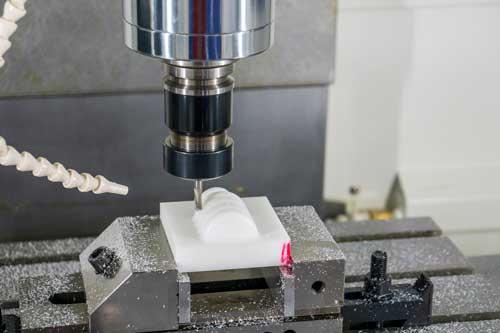 A CNC milling machine creates a part