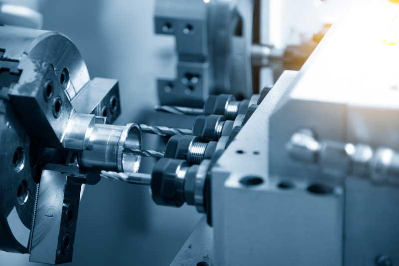 A CNC Swiss machine creating a machined part