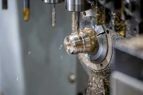 A CNC Swiss machine creates a part