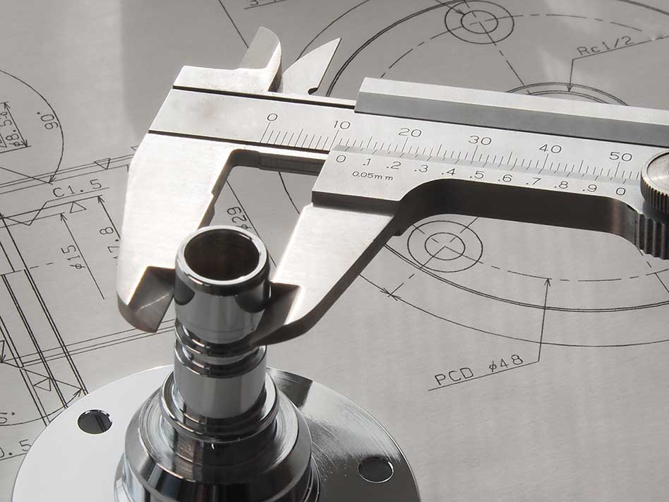 A vernier caliper used as part of a quality control inspection