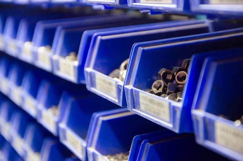 Machined parts in bins